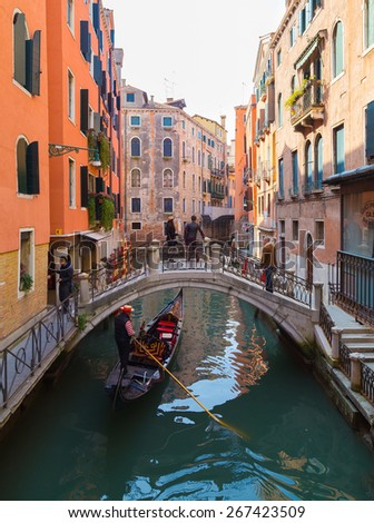 VENICE, ITALY - 14TH MARCH 2015: Streets of Venice during the day, showing buildings, people and Gondolas