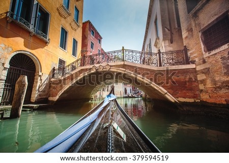 Venice, Italy. View from gondola during the ride through the canals. - stock photo