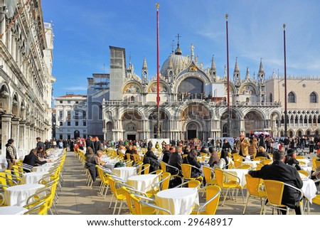 VENICE - JANUARY 28 : Tourists rest at a street cafe at St Mark square January 28, 2009 in Venice, Italy. - stock photo