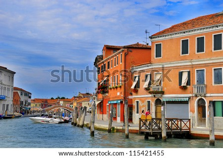 VENICE-JUNE 12: Murano is a series of islands linked by bridges in the Venetian Lagoon, northern Italy on June 12, 2011 in Venice, Italy. More than 20 million tourists come to Venice region annually. - stock photo