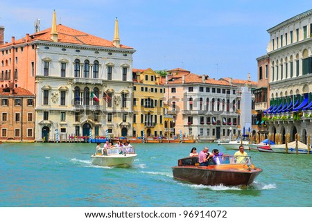 VENICE - JUNE 12: Tourists visit the Grand canal on June 11, 2011 in Venice, Italy. More than 20 million tourists come to Venice annually. - stock photo