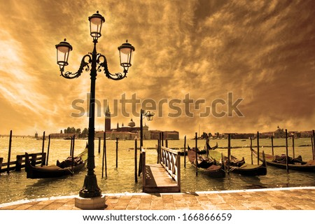Venice lagoon. Gondolas moored by Saint Mark square on the Grand canals at night. Venice, Italy, Europe - stock photo