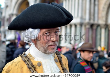 VENICE - MARCH 5: An unidentified person in a Venetian costume attends the Carnival of Venice, festival starting on March 5, 2011 in Venice, Italy.