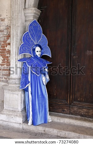 VENICE - MARCH 1: An unidentified person in costume in St. Mark's Square during the Carnival of Venice on March 1, 2011.  The 2011 carnival was held from February 26th to March 8th.
