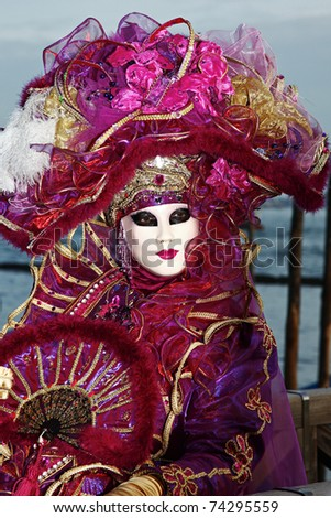 VENICE - MARCH 5: An unidentified person in costume in St. Mark's Square during the Carnival of Venice on March 5, 2011 in Venice, Italy.  The 2011 carnival was held from February 26-March 8, 2011.