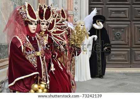 VENICE - MARCH 7: Group of unidentified masked persons in costume in St. Mark's Square during the Carnival of Venice on March 7, 2011. The 2011 carnival was held from February 26th to March 8th. - stock photo