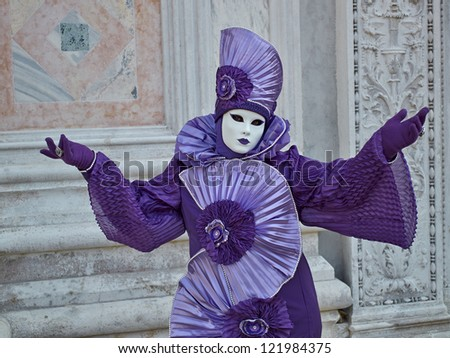 VENICE - MARCH 5: Person in Venetian costume attends the Carnival of Venice, festival starting two weeks before Ash Wednesday on March 5, 2011 in Venice, Italy.