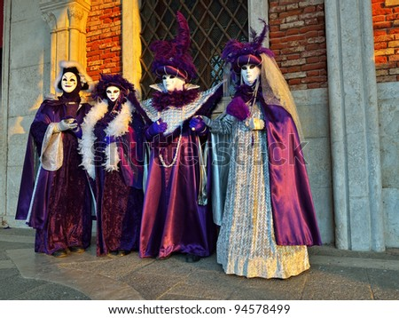 VENICE - MARCH 7:  unidentified masked persons in costume in St. Mark's Square during the Carnival of Venice on March 7, 2011. The 2011 carnival was held from February 26th to March 8th - stock photo