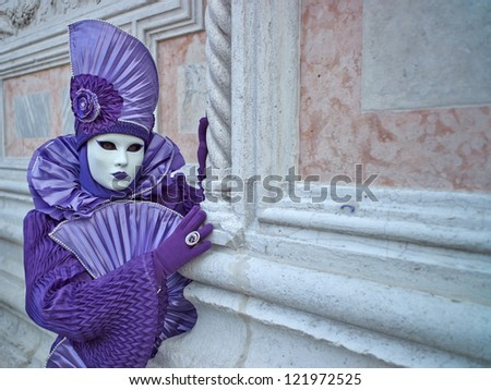 VENICE - MARCH 5: Unidentified person in Venetian costume attends the Carnival of Venice, festival starting two weeks before Ash Wednesday on March 5, 2011 in Venice, Italy.