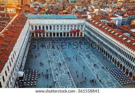 VENICE - NOVEMBER 22: San Marco square with tourists on November 22, 2015 in Venice, Italy. It's the principal public square of Venice, Italy, where it is generally known just as the Piazza. - stock photo