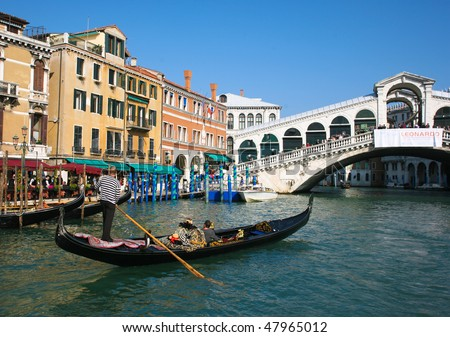 VENICE - OCTOBER 26: Gondola at Rialto Bridge on October 26, 2009 in Venice, Italy. There were several thousand gondolas in the 18th century, with only several hundred today for tourism.