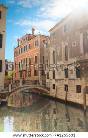 Venice on sunny fall day. Patch of reflected light in camera.