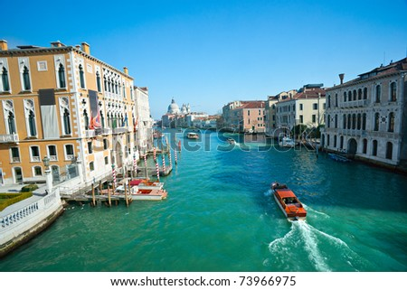Venice, Palace on Grand Canal with Church of santa maria della salute. - stock photo