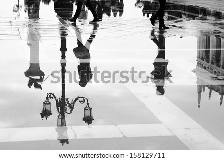 Venice reflects in puddle, Saint Marco square, Italy - stock photo