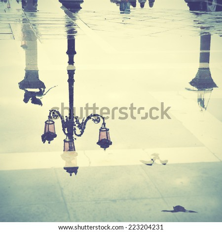 Venice reflects in puddle, Saint Mark's square, Italy. Instagram style filtred image - stock photo