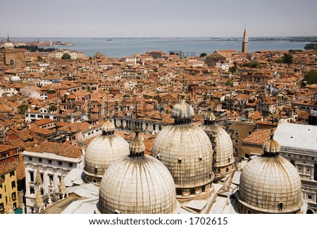 Venice rooftops with the domes of Basilica San Marco in the foreground Venice Italy - stock photo