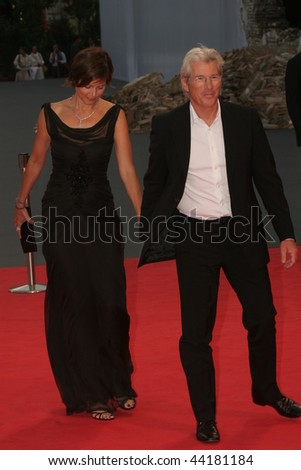 VENICE - SEPT 4:Actress Carey Lowell and actor Richard Gere arrive at the 'I'm Not There' Premiere during the 64th Venice Film Festival on September 4, 2007 in Venice, Italy - stock photo