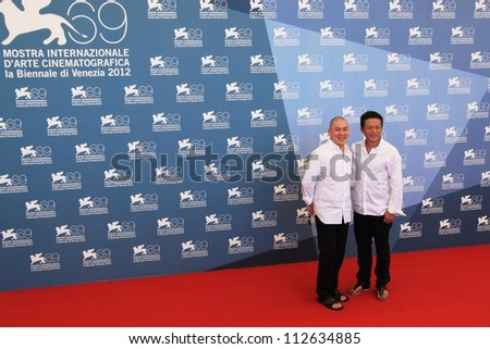 VENICE - SEPTEMBER 8: Tsai Ming Liang and Lee Kang Sheng pose for photographers at 69th Venice Film Festival on September 8, 2012 in Venice, Italy. - stock photo