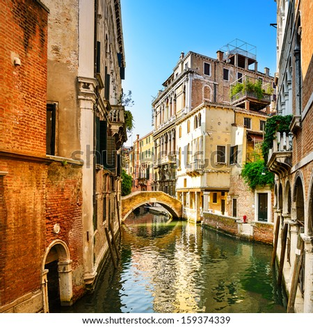 Venice sunset cityscape, water canal, bridge and traditional buildings. Italy, Europe. - stock photo