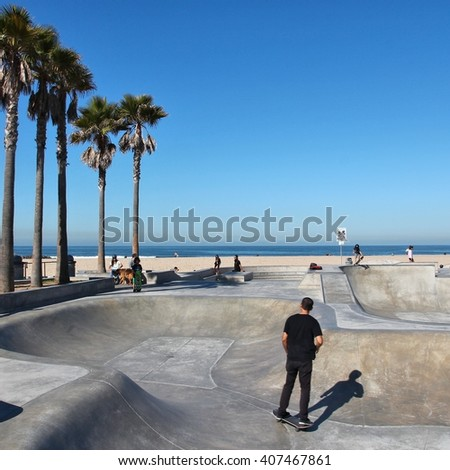 VENICE, UNITED STATES - APRIL 6, 2014: People visit skate park at Venice Beach, California. Venice Beach is one of most popular beaches of LA County. 9.8 million people live in LA County. - stock photo