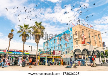 VENICE, UNITED STATES - DECEMBER 18, 2013: big mural in the Ocean Front Walk in Venice Beach, by the artist Rip Cronk who painted some of the most famous murals along the boardwalk and neighborhoods. - stock photo
