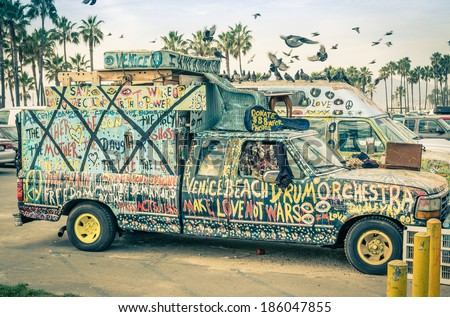 VENICE, UNITED STATES - DECEMBER 18, 2013: hippie artistic minivan on the Ocean Front Walk in Venice Beach. The image has been edited with a vintage retro nostalgic filtered look.  - stock photo