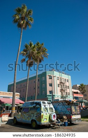 VENICE, UNITED STATES - OCTOBER 15, 2012: Graffiti painted hippie type vans parked on the venice beach boardwalk. - stock photo