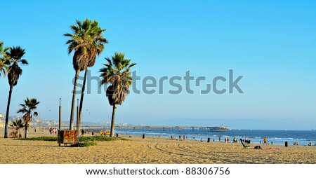 VENICE, US - OCTOBER 17: View of Venice Beach with its Pier in the background on October 17, 2011 in Venice, US. Dozen of movies are filmed in the Venice Pier, a 1,310-foot (400 m) concrete structure - stock photo