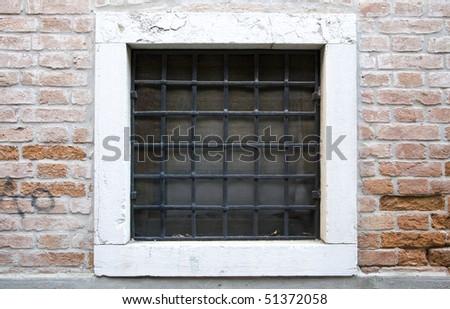 Venice Window with metal bars - stock photo
