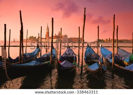 Venice with famous gondolas at gentle pink sunrise light, Italy, European landmark - stock photo