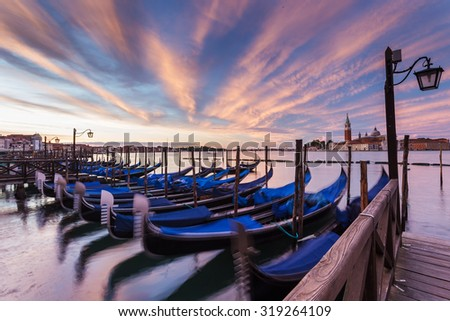 Venice with famous gondolas at sunrise, Italy