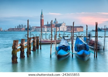 Venice with gondolas on Grand Canal against San Giorgio Maggiore church  - stock photo