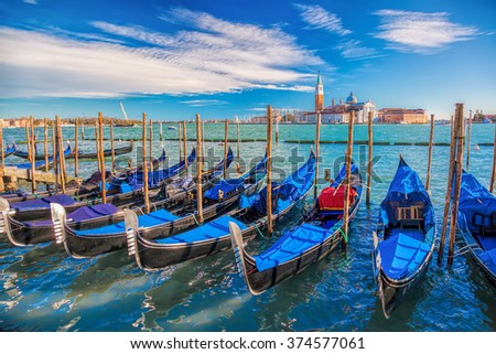 Venice with gondolas on Grand Canal against San Giorgio Maggiore church in Italy - stock photo