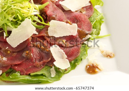 venison carpaccio with Parmesan cheese - stock photo