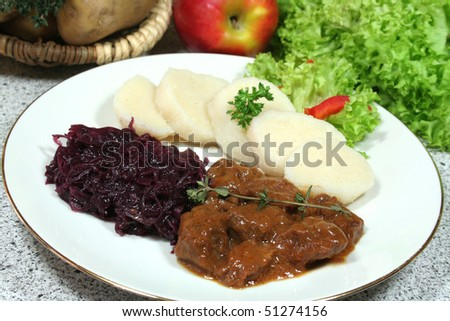Venison goulash with dumplings and red cabbage - stock photo