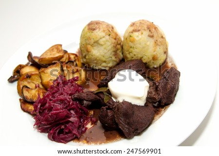 Venison goulash with dumplings, red cabbage and oyster mushrooms - stock photo