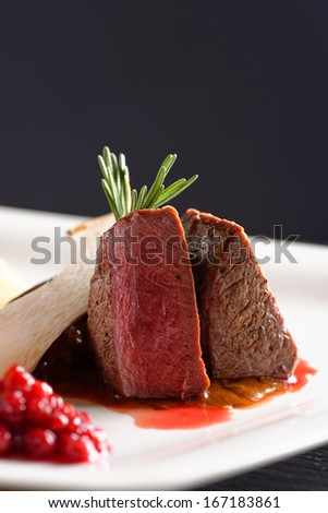 Venison meat steak with red cabbage, cranberries, mushrooms herbs and Potato  - stock photo