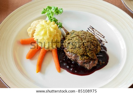venison with whortleberry sause, herb and vegetales - stock photo