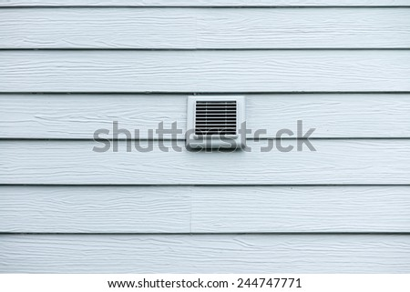 Vent window on wood wall - stock photo