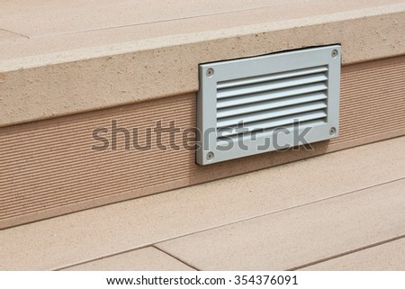Ventilation grate in the steps on the terrace of a hotel
