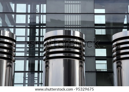 Ventilation Pipes in Front of Modern High-Rise - stock photo