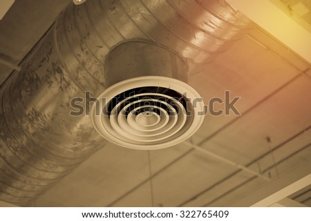 Ventilation pipes of an air condition. Vintage filter. - stock photo
