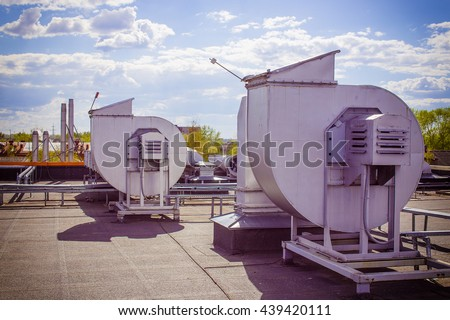 ventilation pipes on a roof. industrial ventilation system on the roof - stock photo