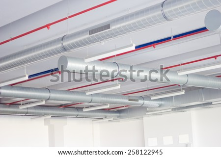 ventilation system and fire alarm system installed on the ceiling - stock photo