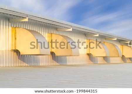 Ventilation system of factory. Hood cover the fan install at wall of factory, sucking air from inside to outside the factory.  - stock photo