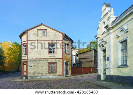 Ventspils, Latvia - May 8, 2016: Old wooden house in Ventspils in Latvia in spring. It is a city in the Courland region of Latvia. Latvia is one of the Baltic countries