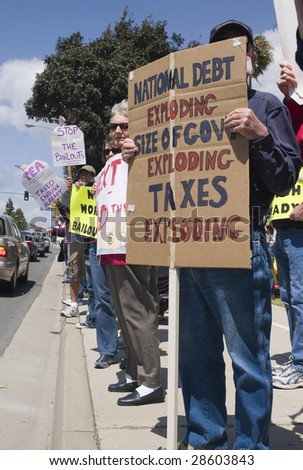 "VENTURA, CALIFORNIA - APRIL 15 : ""Tea Party"" tax spending protesters carry placards April 15, 2009 in Ventura."