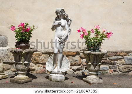 Venus statue in front of a house - stock photo