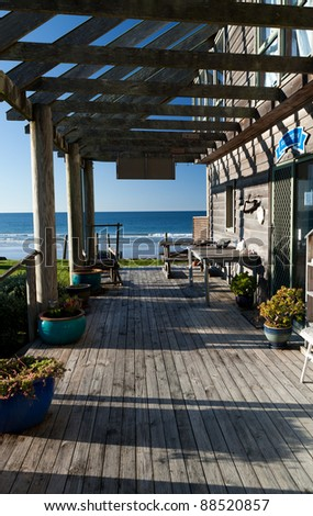 Veranda Of An Old House With Beach View - stock photo