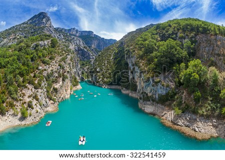 VERDON GORGE, FRANCE - AUGUST 15, 2015: Aerial view of tourists in kayaks and paddle boats. - stock photo